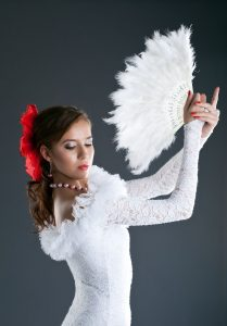 14420520 - woman posing in flamenco white costume with fantail