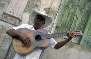35731468 - a salsa music band on the parce cespedes in the city of santiago de cuba on cuba in the caribbean sea.