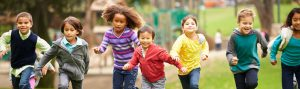 42307426 - group of young children running towards camera in park