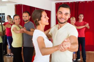 Young romantic couple enjoying of partner dance in dance class