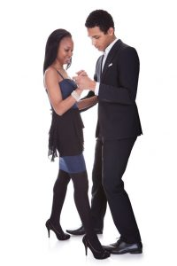 19400071 - portrait of african couple dancing salsa over white background